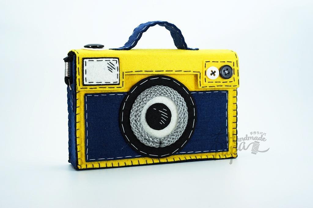 手工袋是按照古董照相机的形状来设计.
